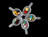 pills spoon isolated on dark background