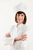 Confident Female Chef on White Background