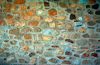 Stone wall texture, stone decoration of house wall.