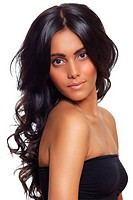 beautiful woman with long black curly hair, tanned skin and natural make_up over white background