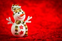 Wool snowman on a red background