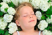 Little girl laying in flowers _ snowball