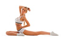 Beautiful blonde in sport wear is making exercises. Isolated image