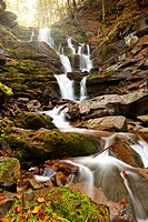 Photo of peaceful flowing mountain waterfall