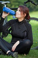 young fitness woman is having a break and drinking water