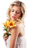 very cute blond curly girl wearing white shirt and with orange lily near her face