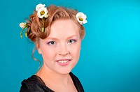 Portrait of beautiful girl blonde with flowers in her hair