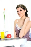 beautiful woman is having breakfaxt at home