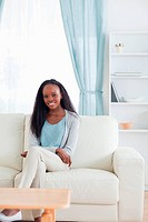 Smiling woman sitting in livingroom