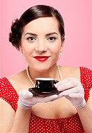 pin_up style portrait of beautiful brunette girl with tea cup