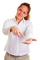 Business woman pointing with finger to her open palm of the hand