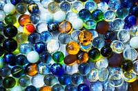 Background with transparent colored glass beads closeup