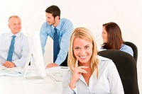 Business team pretty smiling businesswoman portrait happy colleagues around table