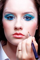 Face make_up of beautiful young woman with makeup brush