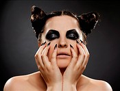 portrait of brunette girl with cat_theme make_up
