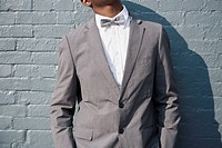 A man wearing a bow tie and suit, midsection (thumbnail)