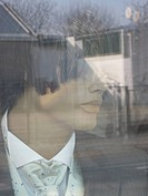 Detail of a male mannequin in a store window