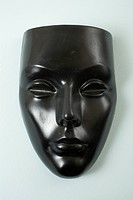 A black mask, female likeness