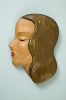 A retro wall hanging, female mannequin profile