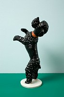 A retro dog figurine begging on its hind legs