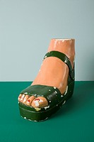 A retro female mannequin´s foot wearing a sandal
