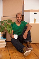 A man taking a coffee break while moving house
