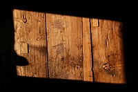 A rectangle shape of sunlight on a wooden structure, close_up