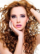 Portrait of a beautiful woman with long curly hairs _ isolated on white