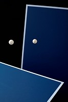 Table tennis tables and balls mid_air