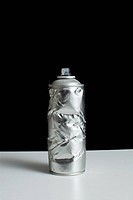 A damaged spray paint can