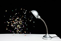 Confetti floating next to a table lamp