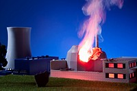 A model built to scale of a nuclear power plant on fire