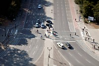 Cars, bicyclists and pedestrians at crossing, tilt_shift, Berlin, Germany