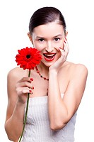isolated portrait of beautiful happy brunette girl with red gerbera flower