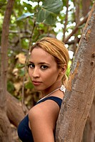 A beautiful young woman leaning against a tree (thumbnail)