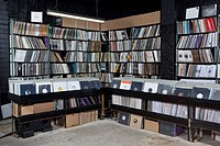 Rows of records on shelves and in bins at a record store (thumbnail)