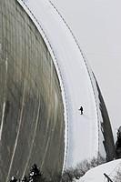 Lone man on the Zervreila Dam in Switzerland