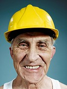 Headshot of a senior man wearing a yellow hardhat