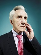 An elegant senior man looking away with a worried expression (thumbnail)