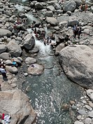 People bathing in a stream, India