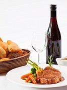Grilled steak , wine and bread on white background