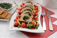 Sliced chicken roll with spinach and mushroom salad with vegetables