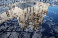 Water reflection of New Cathedral Se Nova in Coimbra, Portugal