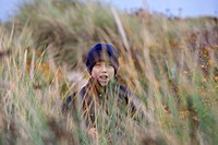 Boy among the beach grass