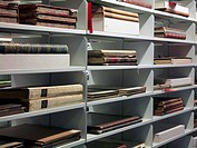 Detail of old books on shelves in a library