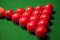 Racked snooker balls on a pool table