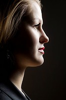 Shadowed profile of young woman