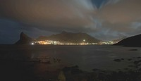 Hout Bay harbour and Sentinel seen from Tintswalo Atlantic lodge at night, Cape Town, South Africa