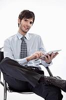 Businessman using tablet pc, portrait