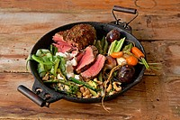 Traditional African cooking. Spiced beef fillet served with assorted vegetables